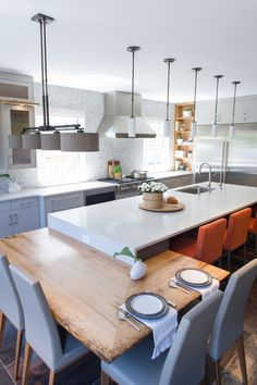 Table wraps around the island.  Contemporary Kitchen by LemonTree & Co. Interiors