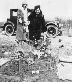 Flowers for a Beloved Pet Pictured in 1926, two women place flowers on a pet's grave at the newly established Hinsdale Animal Cemetery located on approximately seven acres at 64th Street and Bentley Avenue in Clarendon Hills, now Willowbrook, Illinois.