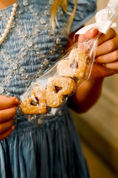 After the wedding receptions, guests took home sleeves of heart-shaped cookies filled with jam.