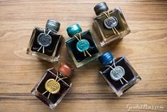 50ml bottle of J. Herbin 1670 Caroube de Chypre (brown) with gold flecks/shimmer, released in July 2016. This is the fifth ink in the 1670 series.