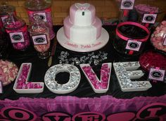 hot pink and black bridal shower styling and candy buffet table