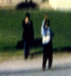 umbrella man jfk: just infront of the umbrella man was a dark skinned man possibly of cuban desent. H stood at the edge of the kirb puntching his fist in the air. Were these siginals?