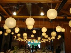 String lanterns on one long wire if you're unable to hang them directly from the ceiling.
