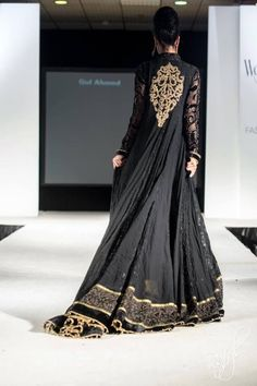 Black Anarkali dress with gold embroidered trim & design on back