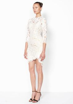 Short white lace dress by Lover Bridal from the White Magick Collection.