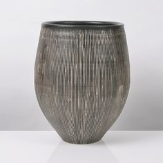 Hans Coper Early Vessel, circa 1953 Stoneware, dark manganese glaze with incised vertical lines inlaid with white slip, impressed HC seal