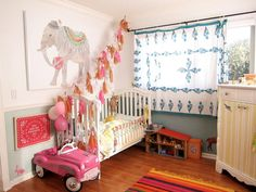 garland.  dresser.  tablecloth curtain. low hanging print.  bright rug.