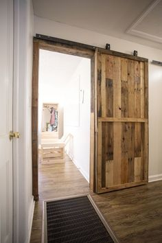 Barn door in the house! Required materials and instructions included. Could use this to make a partition