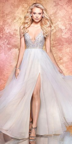 Moondust organza A-line bridal gown, prismatic illusion bodice with bateau neckline and V-neck beaded detail, open net back with stardust frame, full organza skirt with slit.