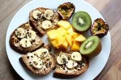 """tobefre-ed: """"My breakfast this morning was vegan French toast with crunchy peanut butter, banana, cacoa nibs and mango, kiwi and passion fruit :) Recipe: Ingredients: two slices of bread or toast, 1/2..."""