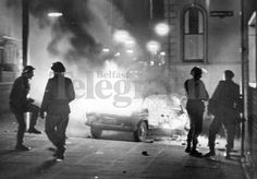 Riots : Belfast. February 1971. All that is left of a car. As soldiers watch, it lights up the night sky in the New Lodge Road riot area. (04/02/1971) | Belfast Telegraph Photosales