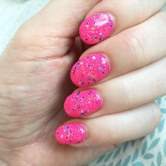 Sinful Colors Baila Baila layered over a hot pink