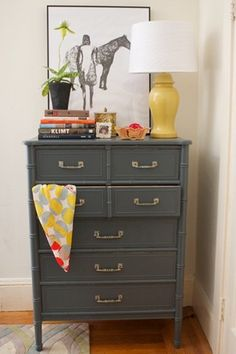 painted Hollywood Regency bamboo dresser!  great idea + Love the yellow bell jar lamp w/ the painting and orchid!