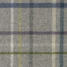 Multicheck Wool Fabric A wool plaid in a mid grey with a multicheck of blue, teal, charcoal sage, yellow and white. Made in the UK.