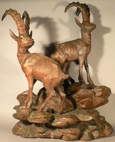 grandiose carved wood ibex sculptures