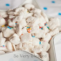 Cake Batter Puppy Chow      5 cups Chex cereal (I prefer the Rice Chex)      10 oz (5 squares) vanilla flavored Almond Bark      1 1/2 cups yellow cake mix      1/2 cup powdered sugar      vegetable shortening, optional