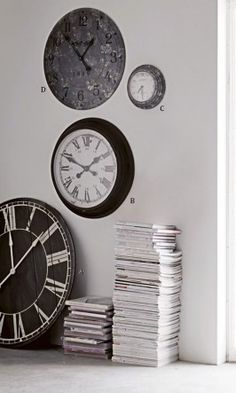 Mixed size wall or floor clocks with a deliberately distressed look and finish. Batteries not included.  A. Large market clock Dia.92cm £298  B. Station clock Dia.50cm £169  C. Studio clock Dia.31cm £69  D. Industrial grey Dia.60.5cm £95