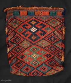 """flatwoven spindle-bag was made by Sanjabi-Kurds during the 19th century, measures 43cm x 36cm (1' 5"""" x 1' 2""""). Front"""