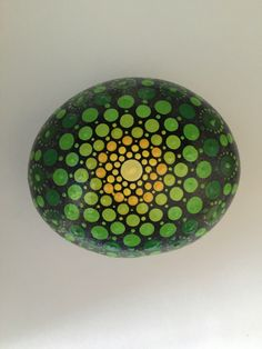 A personal favorite from my Etsy shop https://www.etsy.com/listing/465073595/mandala-stone-large-hand-painted-rock