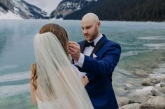 Epic Blue Ice on a freshly frozen Lake Louise makes a stunning backdrop for this winter wedding in the mountains! See more on the blog! Winter wedding inspiration in the Canadian Rocky Mountains. Adventurous winter elopement on newly frozen mountain lake with amazing blue ice. Romantic  winter wedding ideas. Rare blue ice at Lake Louise for an intimate November winter wedding. Where to get married in the mountains. Where to elope in winter for the best photos. Winter Mountain Wedding, Outdoor Winter Wedding, Local Photographers, Portrait Photographers, Couple Portraits, Wedding Portraits, Winter Wedding Inspiration, Wedding Ideas, Fairmont Chateau Lake Louise