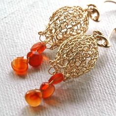 Dangle knitted gold Wire crochet earrings in the shape of a small pomegranate , the earrings are handmade using gold filled wire, they are eye catching and symbolizes many good things in life. The kni
