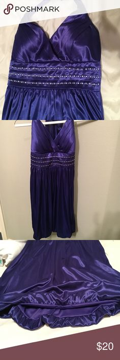 Royal Blue Dress Halter Royal Blue Dress with jewels in the middle. Last picture shows bottom of dress, is slightly fitted in. Dresses Strapless