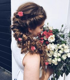 Messy combination of braids with roses to accessorize