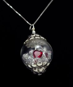 This is one of our new jewelry designs. Beautiful glass globe pendant filled with round brilliant diamond cut swarovski crystals, with a lovely red cz heart. Our new shop GlobalDiamondation/etsy