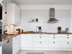 White subway tiles and black grout are still my dream backsplash for my future non-rental kitchen. I really like how this grid looks against the wood and the green herbs.