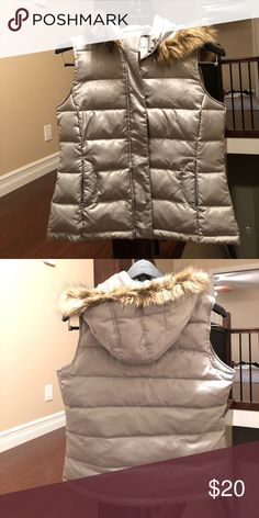 Talbots Silver puffy vest with hood size Small Talbots puffy vest.  Down filled. Front zip with snap closure.  Front zippered pockets.  Removable hood with faux fur trim.  Silver size small. Like new condition only worn a few times Talbots Jackets & Coats Vests