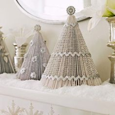 A mini forest of silvery trees made from paperback books adds a shimmering touch to the mantel. - FamilyCircle.com