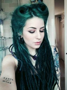 Green hair. Alternative style. Dreads.
