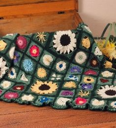 Crocheted Flowers Afghan from Carole Anne Cross of Chula Vista, California - free pattern on Country Woman Magazine website