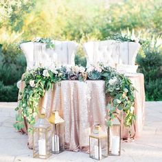 Rose Gold Sequin Sweetheart Table with Kings Chairs // garland, greenery, lanterns, bride and groom, romantic, outdoor, centerpiece