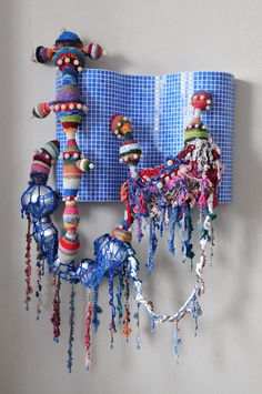 Joana Vasconcelos ~ Hockney Pool, 2011 ~  Mosaic tiles, handmade woollen crochet, ornaments, polyester, MDF, iron ~   182 x 128 x 50 cm
