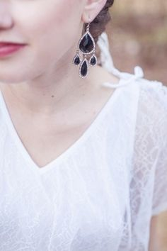 black earrings. a perfect October bridal accessory
