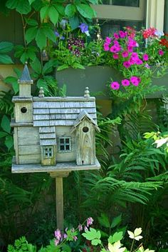 What a beautiful, more than one birdhouse!! I would love to have it in my garden!