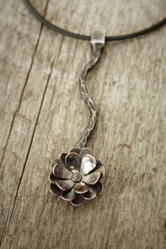 Flower pendant. forged steel with copper.