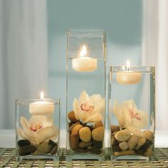 with green candles and turquoise submergable lights also different flowers?