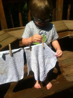 Clothsline activity. Fun idea for the summer.  Use with the water table and work on fine motor skills at the same time. Good for team building as well.