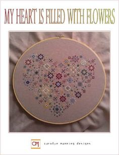 My Heart Is Filled With Flowers is the title of this cross stitch pattern from CM Designs.