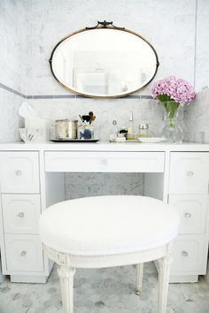 All marble vanity: http://www.stylemepretty.com/living/2016/11/02/giving-an-outdated-bathroom-a-stunning-and-timeless-makeover/ Photography: Sabra Lattos - http://sabralattos.com/