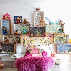 boxes with colorful paper backings used as shelves in kids room
