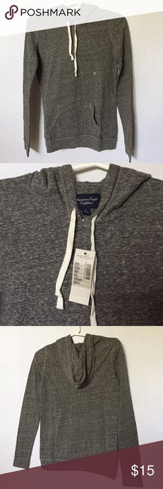 American Eagle Outfitters Hooded Sweater Grey heather lightweight drawstring hoodie from American Eagle Outfitters. NWT. Size small. Front kangaroo pocket. 60% cotton, 40% polyester. Great to layer on top of a tank in the Fall! American Eagle Outfitters Sweaters