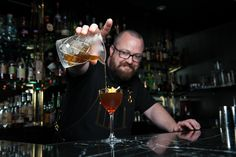 """If you find yourself in a coveted seat at the bar in The Punch Room at The Ritz-Carlton, Charlotte, catch Bob in action crafting his signature spirits. When capturing movement, use the """"photo burst"""" mode on your mobile device for crisp, blur-free images."""