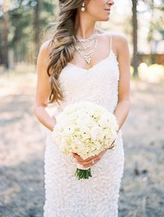Classic white round bouquet: Photography : Amanda K Photography Read More on SMP: http://www.stylemepretty.com/oregon-weddings/sisters/2016/07/13/rustic-pacific-northwest-outdoor-wedding/