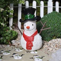 """Snowman by Seasonal. $4.99. material: Resin and Metal. size: 3"""" High. It 's snowing! It is an exciting day, because the snowman, dressed in a black top hat with a red scarf draped around his neck, is happy to enjoy the mini garden. Note: To add snow to your indoor mini-garden, use Snow Real."""