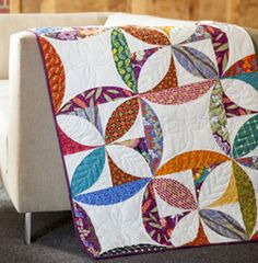 This modern fat quarter friendly quilt is perfect for spring! Bright colors and lovely hues make this perfect for scraps and more!