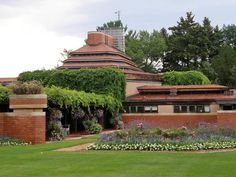 Frank Lloyd Wright Jr Architecture Of Brick Home Designed With Beautiful Garden In Facade View