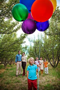 "Balloons add a colorful pop to family pictures! This idea would be especially meaningful for ""Up"" fans."
